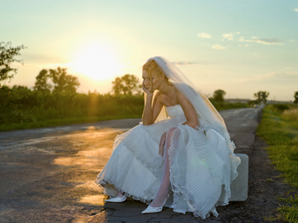 Bride Sitting on Side of Road --- Image by © Roy Botterell/zefa/Corbis